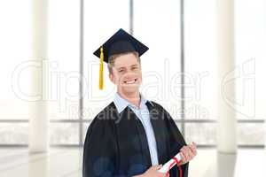 Composite image of a smiling man with a degree in hand as he loo