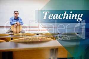Teaching against male teacher sitting on chair in lecture hall