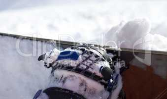 Snowboard and boot in binding on off-piste slope