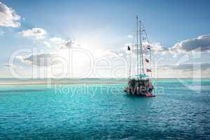 Yacht near island