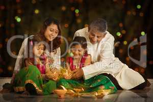 Indian family celebrating Diwali, fesitval of lights