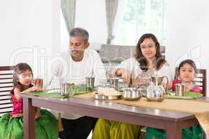 Indian family dining in kitchen