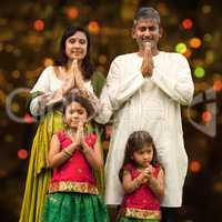 Indian family greeting on diwali