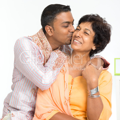 Indian family, son kissing mother