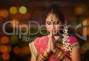 Indian girl praying