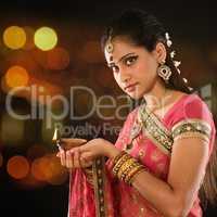 Indian girl hands holding diya lights