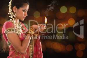 Indian girl hands holding diwali lights