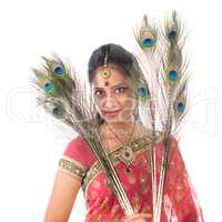 Indian girl with peacock feathers