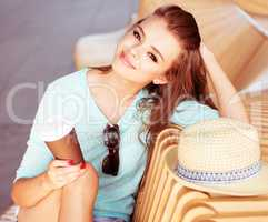 Attractive Woman with Coffee Sitting on the Chair