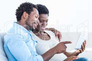 Husband pointing towards digital tablet