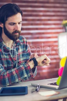 Smart businessman checking time