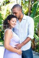 Husband kissing pregnant wife head