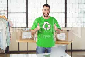 Portrait of happy man in recycling symbol tshirt showing thumbs