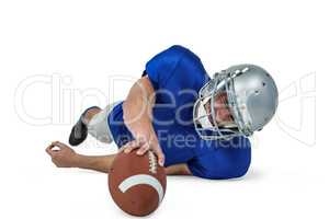 American football player struggling to catch the ball