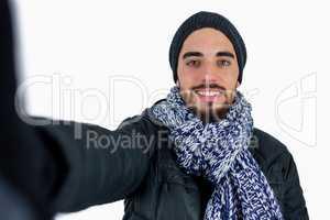 Bearded man using a selfie stick