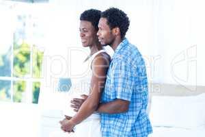 Husband embracing pregnant woman