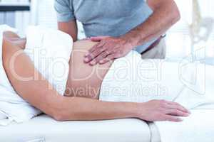 Masseur giving massage to pregnant woman