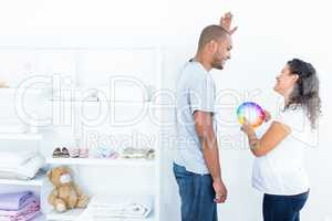 Couple choosing color for a room