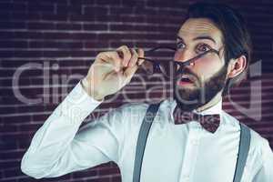 Fearful man holding eyeglases