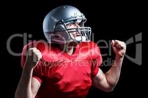 American football player cheering with clenched fist