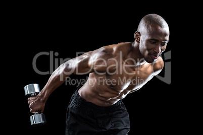 Muscular man bending while exercising