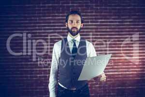 Confident man holding document