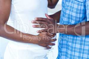 Husband touching belly of wife