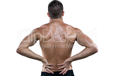 Rear view of shirtless athlete with back pain
