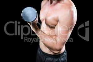 Midsection of shirtless sports player working out with dumbbell