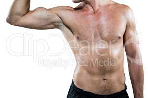Midsection of shirtless athlete flexing muscles