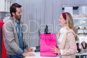 Smiling woman talking to cashier