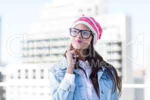 Thoughtful woman looking up with finger on cheek