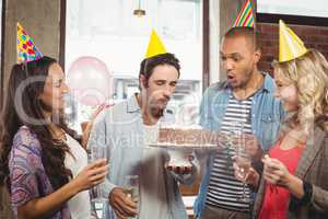 Man blowing candle on cake at celebration