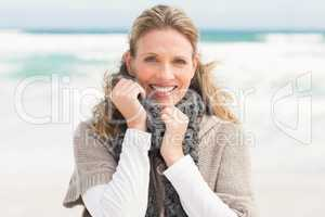 Smiling woman wearing winter clothing