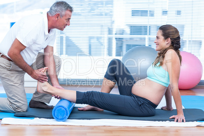 Instructor teaching exercise to pregnant woman