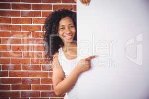 Smiling woman pointing to white board