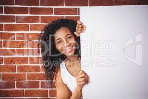 Smiling woman holding white board
