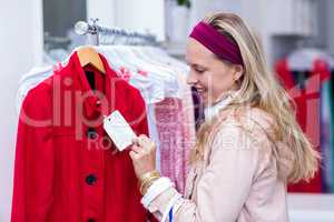 Smiling woman looking at price tag