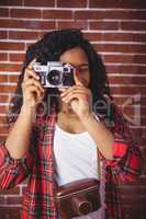 Hipster using a retro style camera