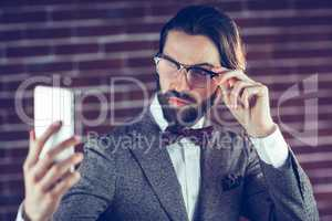 Fashionable man taking picture of himself
