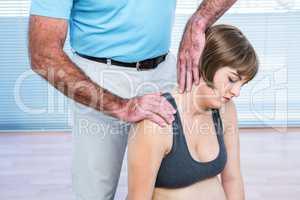 Therapist massaging pregnant woman