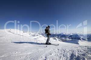 Skier on top of ski slope