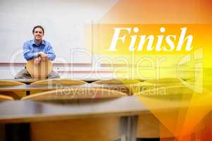 Finish against male teacher sitting on chair in lecture hall