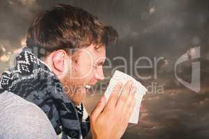 Composite image of close up side view of man blowing nose