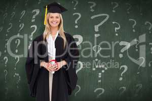 Composite image of smiling blonde student in graduate robe