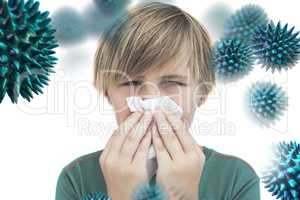 Composite image of sick little boy with a handkerchief