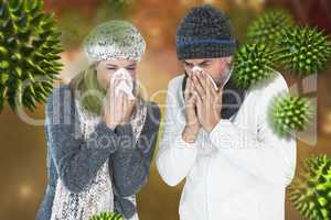 Composite image of couple sneezing in tissue