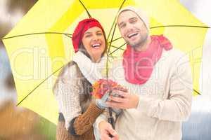 Composite image of autumn couple holding umbrella