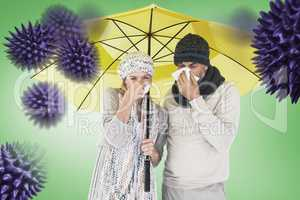 Composite image of couple sneezing in tissue while standing unde