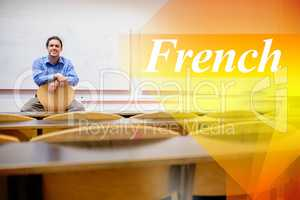 French against male teacher sitting on chair in lecture hall